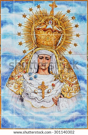 CORDOBA, SPAIN - MAY 26, 2015: The ceramic tiled, cried Madonna on the facade of church Iglesia de Nuestra Senora de Gracia by Catalina Alaide from 20. cent. - stock photo