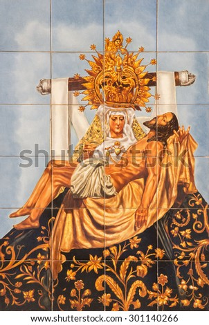 CORDOBA, SPAIN - MAY 26, 2015: The ceramic tiled Pieta on the facade of church Iglesia de San Augustin by artist Mensaque Rodriguez from 20. cent. - stock photo