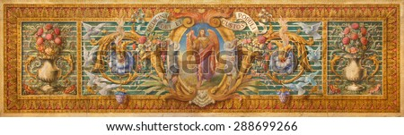 CORDOBA, SPAIN - MAY 27, 2015: The detil from baroque paint on the altar in Basilica del Juramento de San Rafael with the floral motive and archangel Raphael in the centre by unknown artist. - stock photo