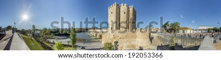 CORDOBA, SPAIN - OCTOBER 30, 2013: The Calahorra Tower is a fortified gate built by the Almohads to protect the nearby Roman Bridge in the Historic center of Cordoba, Andalusia, Spain.