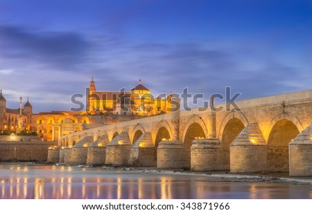 Cordoba, Spain, old town seen from the river at sunset. - stock photo
