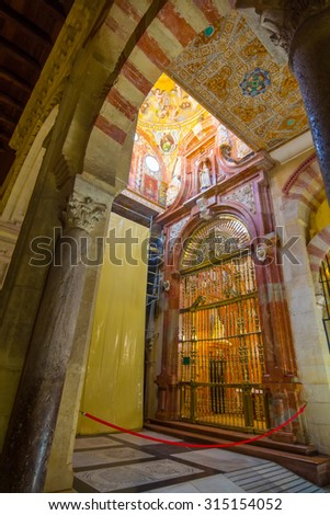 CORDOBA, SPAIN September 5, 2014:  arches and columns of red and white color of the famous mosque  September, 5, 2014 in Cordoba, Spain