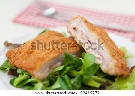 Cordon bleu with salad - stock photo