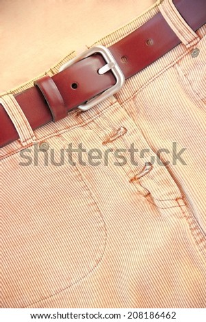 Corduroy skirt with leather belt. - stock photo
