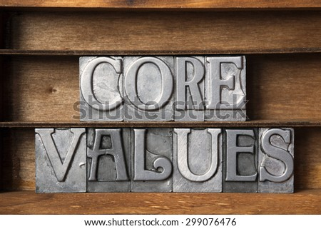 core values phrase made from metallic letterpress type on wooden tray - stock photo