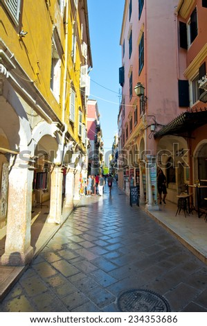 CORFU-AUGUST 27: Kerkyra narrow street in the old town with the row of souvenirs shops on August 27, 2014 on Corfu island, Greece.