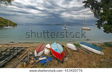 Corfu, Greece - August 10, 2013: Old colored wrecked boats in harbor of Corfu island