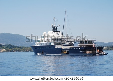 CORFU, GREECE - JUNE 23, 2014: Super yacht Le Grand Bleu moored in Kerkira harbour on the Greek island of Corfu. The 113mtr long luxury boat was built in Germany in 2000. - stock photo