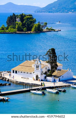 Corfu symbol Pontikonisi island and Vlacherna Monastery as seen from above. Kerkyra island also known as Corfu Greece - stock photo