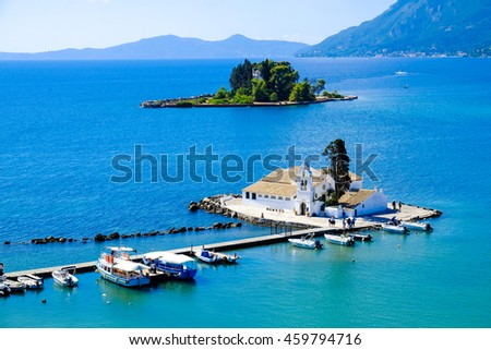 Corfu symbol Pontikonisi island and Vlacherna Monastery as seen from above. Kerkyra island also known as Corfu Greece. Aerial view - stock photo