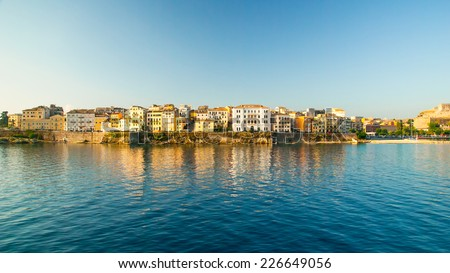 Corfu town - Greece. View from the sea. Looking towards the buildings of Corfu Town from Kerkira harbour on the Greek island of Corfu. Corfu is the second largest of the Ionian islands. - stock photo