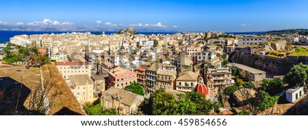 Corfu town panorama over the old city. Venetian fortress in background and old clock tower, city symbol. - stock photo
