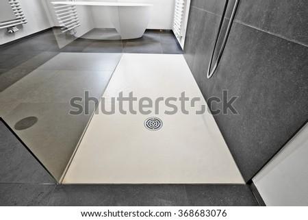Corian floor and drain from modern shower in luxury bathroom - stock photo