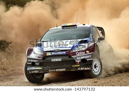 CORINTHIA, GREECE - JUN 1: Belgian driver Thierry Neuville and his codriver Nicolas Gilsoul in a Ford Fiesta RS WRC race in the 59th Acropolis Rally of Greece, on Jun 1, 2013 in Loutraki, Greece. - stock photo