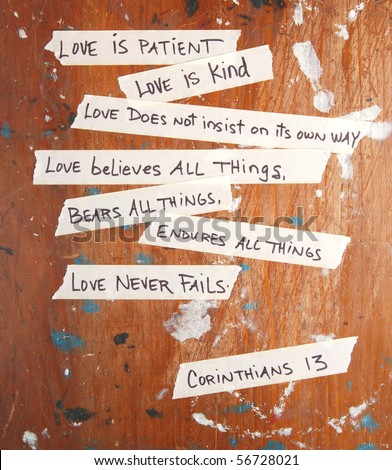 Corinthians 13 written on masking tape stuck to an old board - stock photo