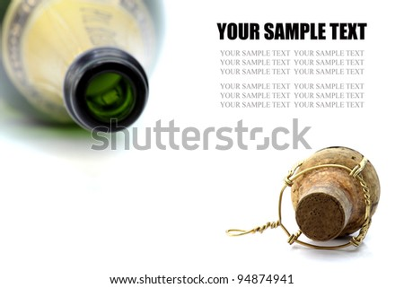 Cork and bottle of champagne - stock photo