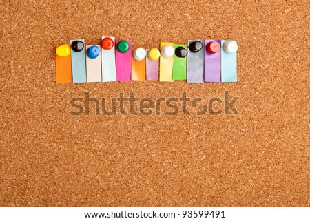 Cork board and colorful heading with copyspace for a twelve letter word - stock photo