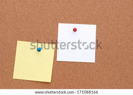 Cork board with a piece of paper - stock photo