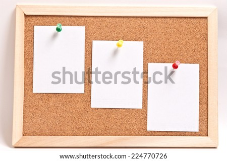 Cork board with blank notes, isolated on white