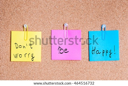 Cork board with multicolor notes, clipping path included, don't worry, be happy