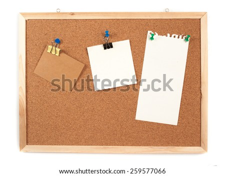 Cork board with several blank notes with pins on white background