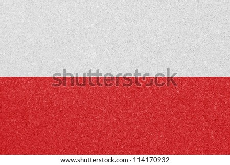 Cork board with the flag of Poland painted on it - stock photo
