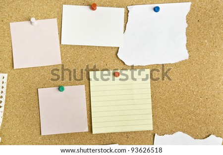 Cork bulletin board with notes.