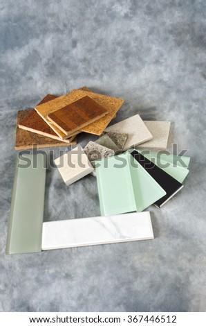 cork flooring glass subway tile for backsplash quartz countertop remnants or samples isolated on gray background - stock photo