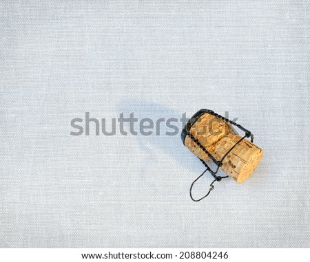 Cork from a bottle of champagne over canvas background - stock photo