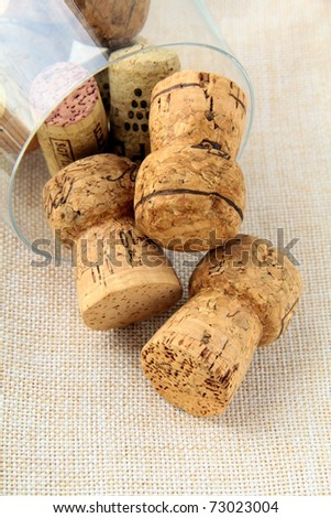 cork from bottles of wine in the glass on a pink napkin - stock photo