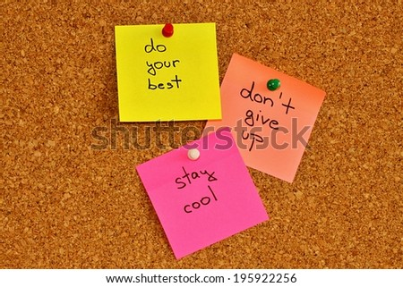 Cork notice board with three colourful sticky note pads - stock photo
