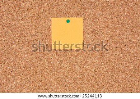 Cork noticeboard with a color note a over white background