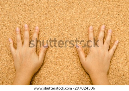Cork textured with two hands - stock photo