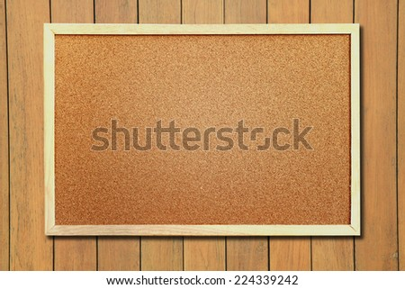 Corkboard on natural wooden background - stock photo