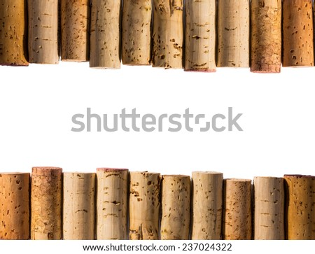 Corks arranged at top and bottom as borders with white background in the middle. - stock photo