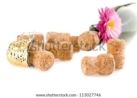 corks, flower and bottle of champagne on a white background - stock photo