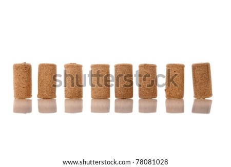 Corks from bottles guilt on white background. - stock photo