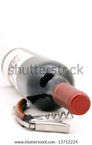 Corkscrew and red wine bottle