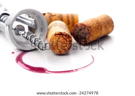 Corkscrew  and red wine stain over white background - stock photo