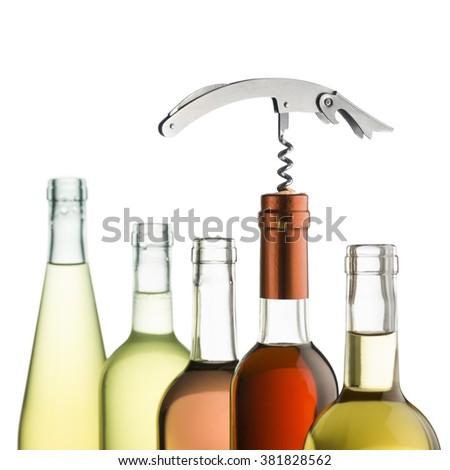 corkscrew inserted on wine bottles on white background - stock photo