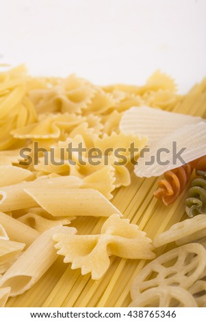 Corkscrew Pastas and Italian Ingredients on white background