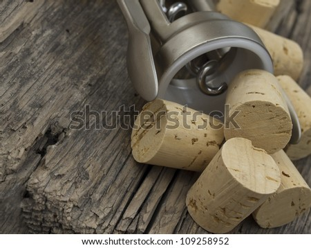 corkscrew with corks - stock photo