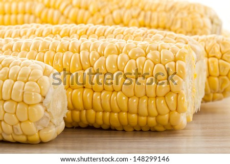 corn cob with green leaves  - stock photo