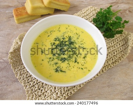 Corn cream soup with garden herbs  - stock photo