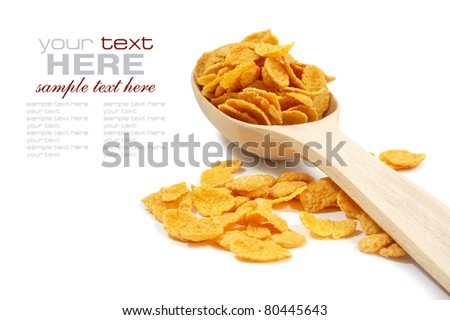 Corn flakes and wooden spoon isolated on white - stock photo