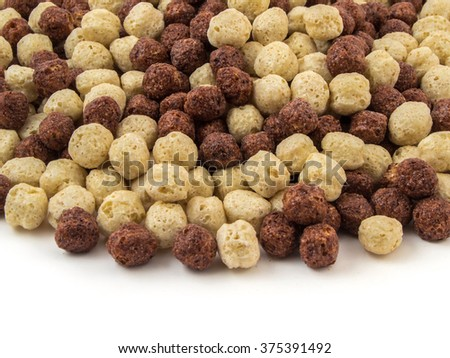 Corn flakes breakfast cereal in a white and brown bowl. - stock photo