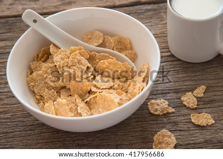 Corn flakes cereal in a white bowl. - stock photo