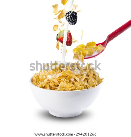 Corn Flakes Falling On Bowl With Berries, Milk and Red Spoon. Health Breakfast - stock photo