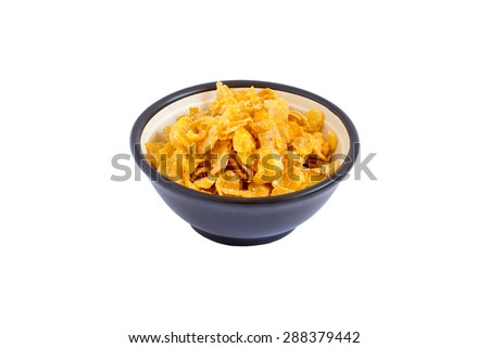 Corn flakes heap in a glass bowl - stock photo