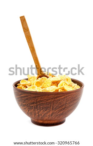Corn flakes in a bowl of ceramic and wooden spoon isolated on a white background.